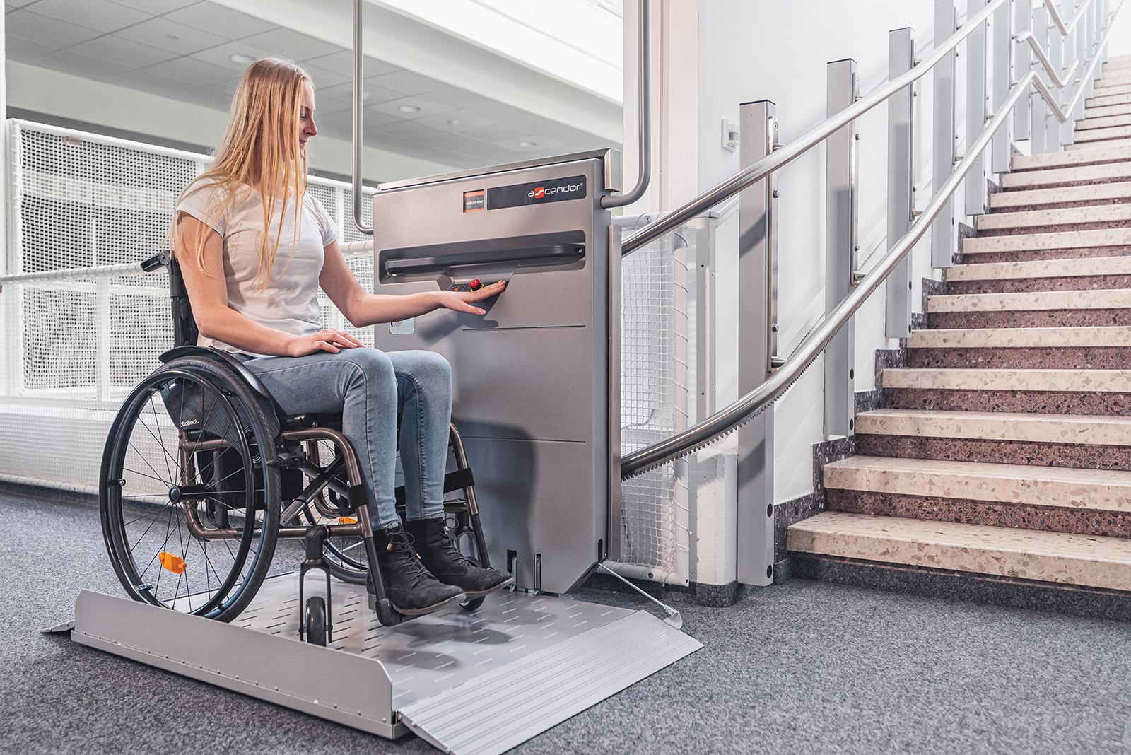 Woman in wheelchair uses an Ascendor Platform Stair Lift